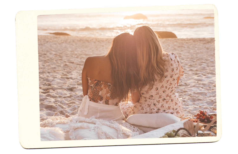two girls beach picnic
